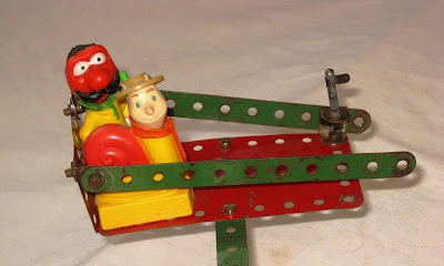 Zebedee and Brian enjoying the Meccano roundabout ride