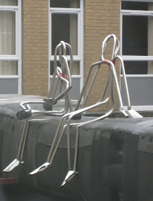 Zimmer frame sculpture of two figures