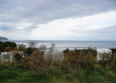 View past caravans out to sea with a cloudy sky