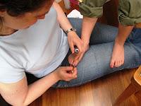 Lola II painting A's toenails