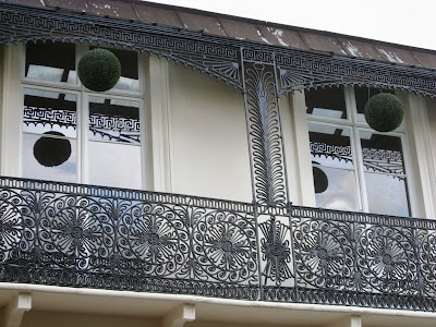 Regency balcony with wrought iron and hanging foliage balls
