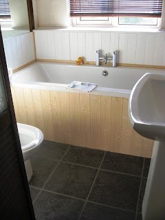 View of bathroom with slate tiled floor