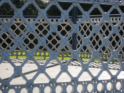 Lattice patterns formed by the metalwork of the side of the bandstand