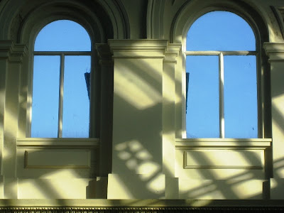 Blue sky through two arched windows