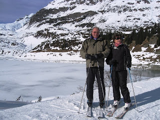 J&C on skis with frozen lake in the background