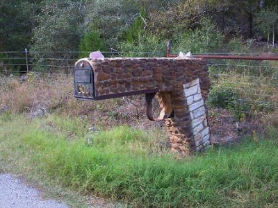 Photo of mailbox shaped like a gun