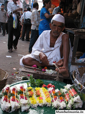 old man making garlands