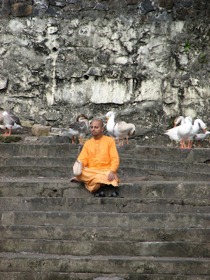 Pujari (Hindu monk) sitting on steps