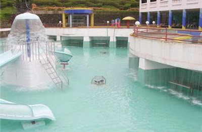 The Swimming pool and water slides at Rivergate resort