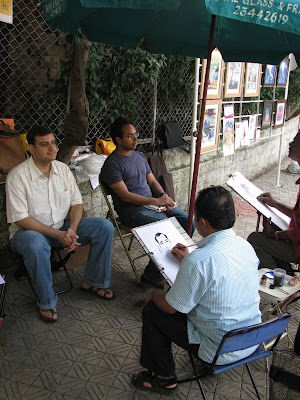 Caricature artist at Kala Ghoda