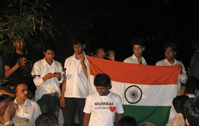 Mumbai locals wave Indian flag