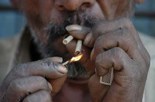 Worker smoking bidi