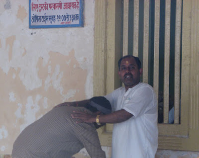 Pujari giving blessings to devotee