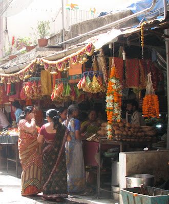 Temple shops selling garlands and coconuts