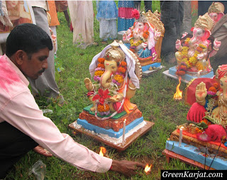 man worshiping Ganesh idol