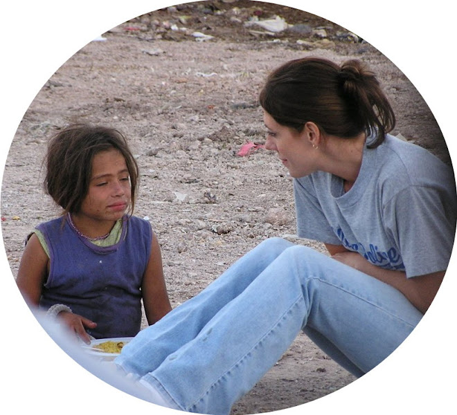 Valerie with a child in the city dump, Tegucigalpa, Honduras