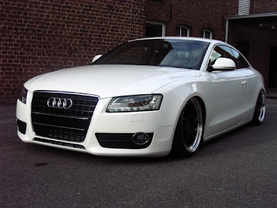white audi a5 with with black rims and lowering springs