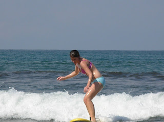 Molly surfing in Costa Rica
