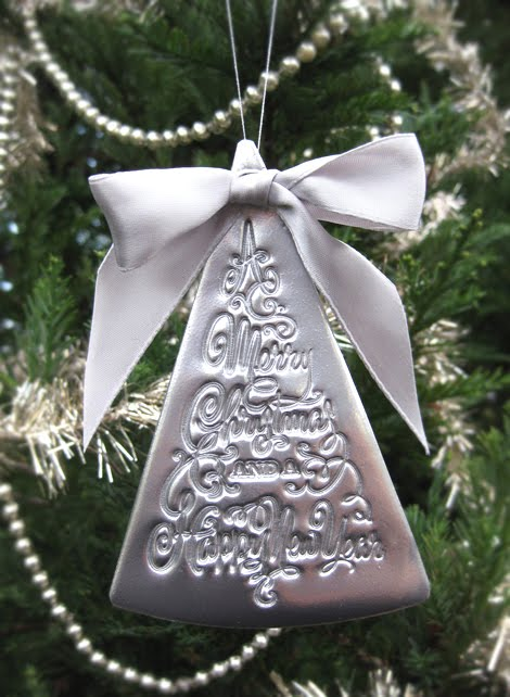This beautiful stamped clay xmas decoration was made from just