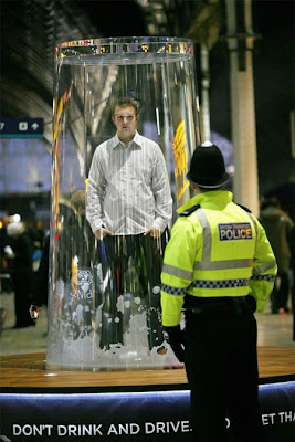 Man trapped under a giant glass.
