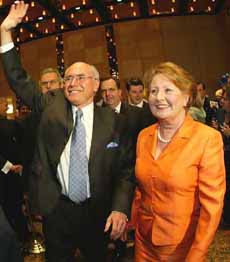 Photo shows Prime Minister John Howard with wife Janette