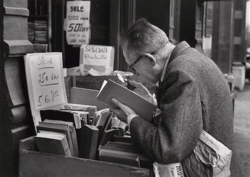 André Kertész: On Reading. Fourth Avenue, New York (man reading at outdoor book stall), June 4, 1959