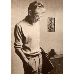 Photograph of Samuel Beckett holding a leather portfolio