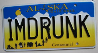 Alaska souvenir vanity Centennial plate reading IMDRUNK