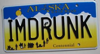 Alaska souvenir vanity Centennial plate reading IMDRUNK