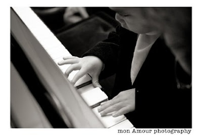 cute kid playing the piano