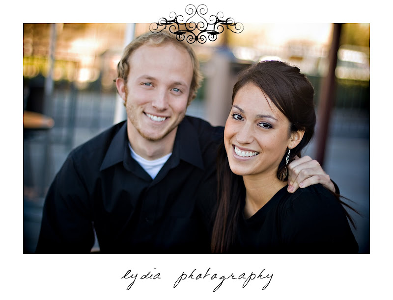 Bride and groom sitting at lifestyle park engagement portraits in Auburn, California