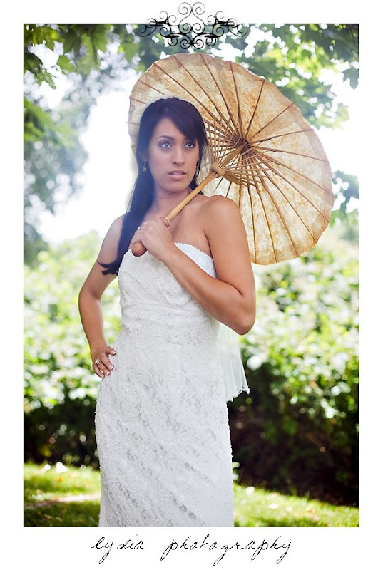 Bride with a parasol for a trash the dress bridal wedding shoot in Sacramento, California