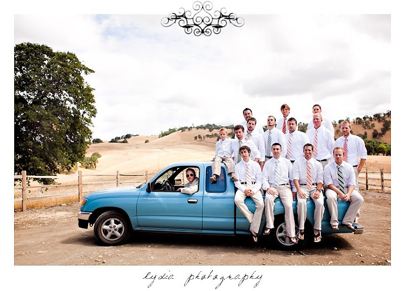 Groomsmens' picture in a blue truck in Rumsey California