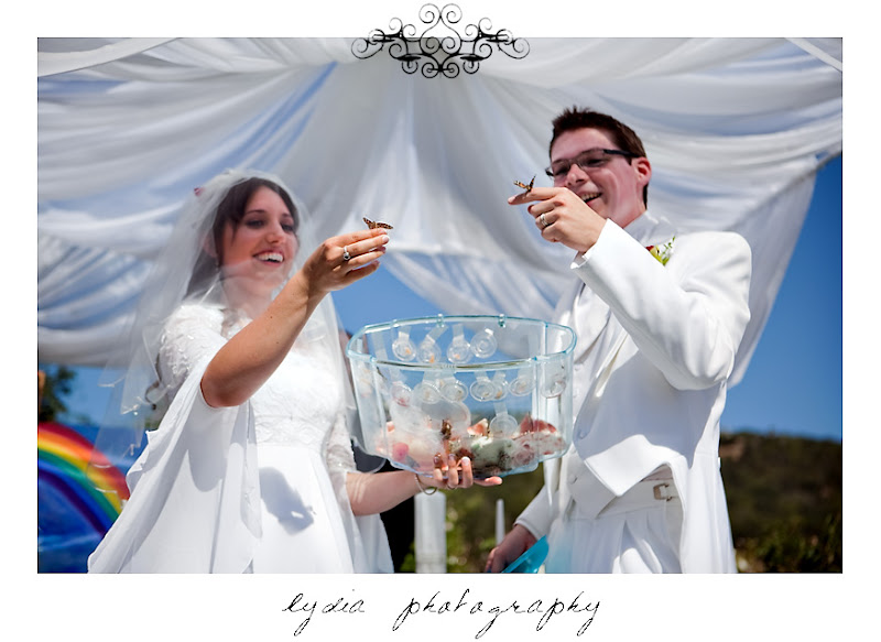 Rosemary and Jared releasing butterflies during the wedding in Santa Rosa California