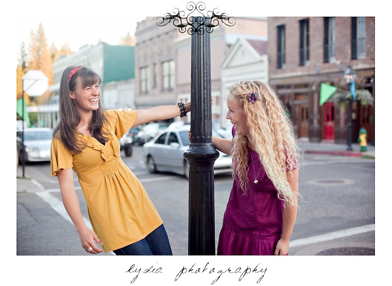 Jessica and Sarah laughing for their portraits in Nevada City California