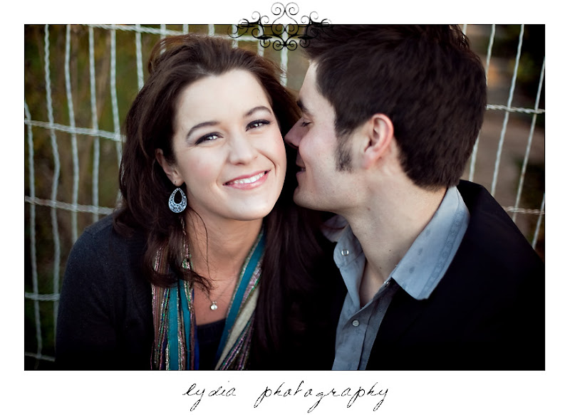 Groom kissing his bride at lifestyle old town engagement portraits in Cottonwood, California