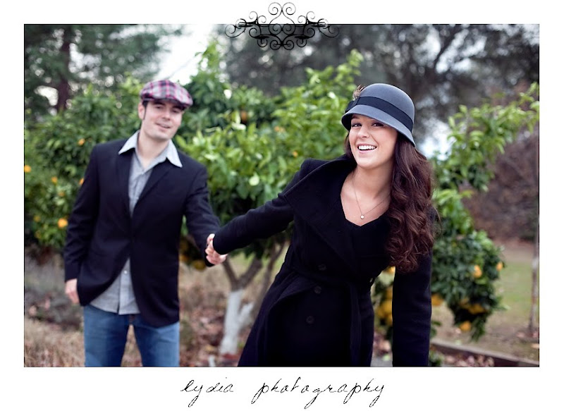Alicia and Chris' engagement pictures in front of the orange tree in Cottonwood California