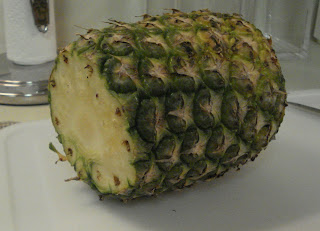 Cut the top and bottom off the pineapple
