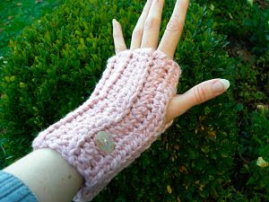 pink washable organic cotton crocheted fingerless gloves with buttons