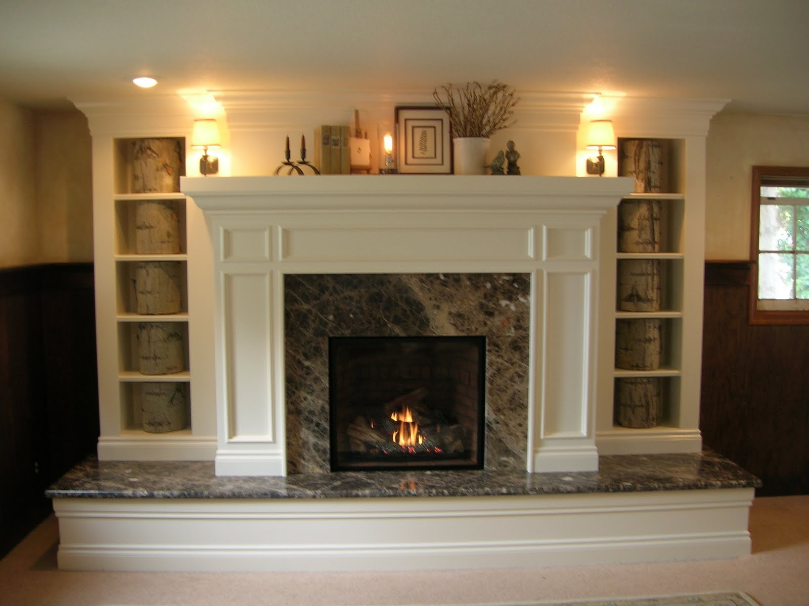 how to cover brick with wood and marble on this modern fireplace
