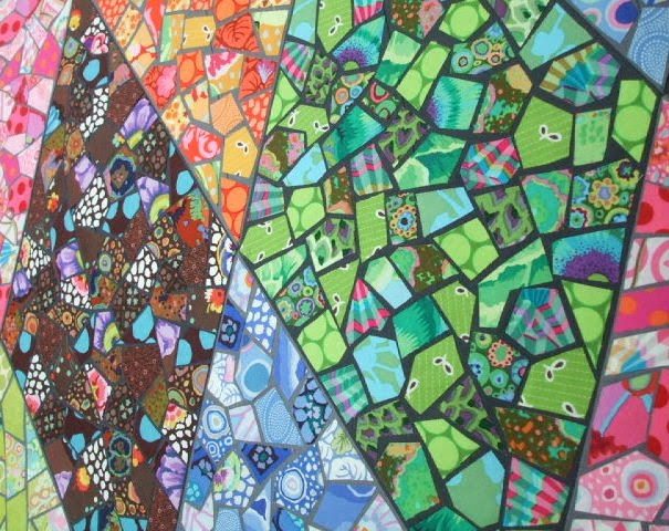 this quilt is based on kaffe fassetts facet quilt from