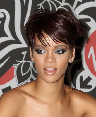 Rihanna is wearing a short hairstyle with bangs.