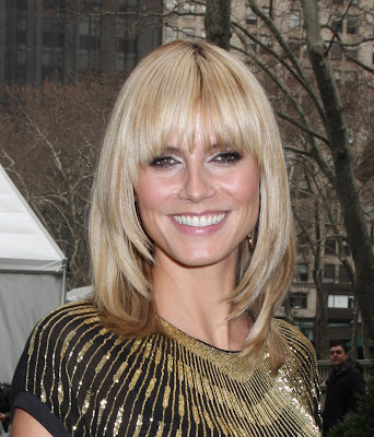 short blonde hair bangs. Long blonde hair was cut into graduated layers with heavy blunt fringe and