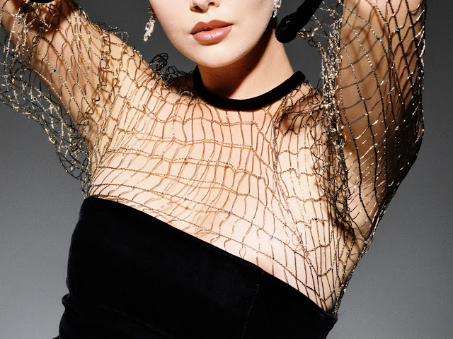 Charlize Theron nip slip in black dress