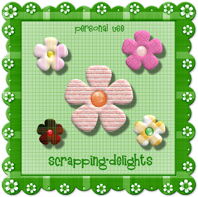 http://scrapping-delights.blogspot.com/2009/08/fabric-flowers-freebie.html