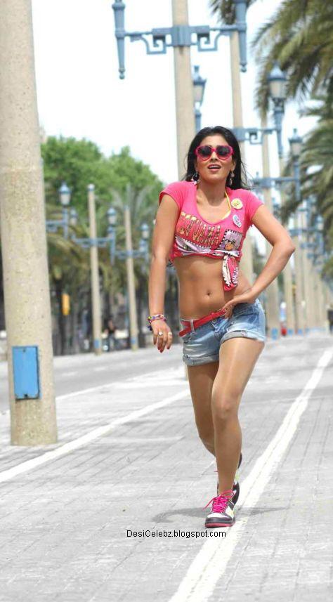 Shriya Saran posing in sexy shorts
