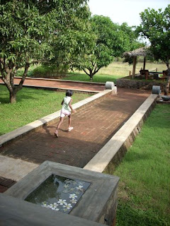 thilanka hotel and spa dambulla sri lanka child running on brick path