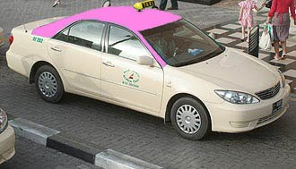 A pink taxi