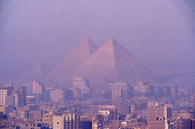 Giza pyramids soaring above the city Picture