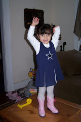 Sophia in her cowboys outfit...for grandpa Z (dad is not happy!)